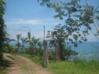 dominical real estate, ocean view house for sale, bay view home, huge extra building pad, b&b location, close to beaches and shopping, incredible views, dominicalito, escalares homes for sale