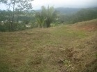 uvita real estate, easy access ocean view property, ocean view lot in uvita, close ot the road, close to the beach, finished building site, uvita property for sale
