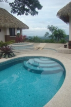 ojochal real estate, dominical real estate, polynesian style home, ocean view estate, 8.2 acres, home with pool, 3 structures, new home for sale